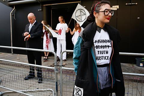 Climate activists storm London Fashion Week | Sky News Australia