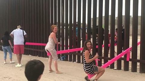 Pink seesaws break great US-Mexico divide   Sky News Australia