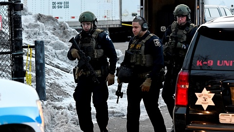 Five dead and officers wounded in mass shooting near Chicago