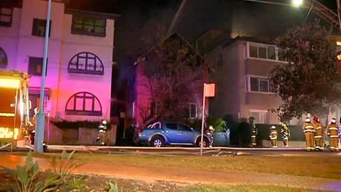 Woman hospitalised after fire engulfs Sydney apartment block | Sky News Australia